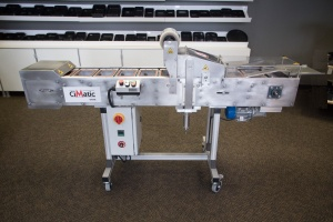 This is  picture of the CiMatic Automatic Tray Sealer which is used to seal CPET, PP and APET trays.